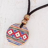 Wood pendant necklace, 'Wise Maya' - Pinewood Pendant Necklace with Mayan Motifs from Guatemala