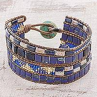 Glass beaded wristband bracelet, 'Seafaring Fashion' - Blue Glass Beaded Wristband Bracelet with Magnesite Button