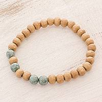 Jade and wood beaded stretch bracelet, 'Ancient Nature' - Jade and Pinewood Beaded Stretch Bracelet from Guatemala
