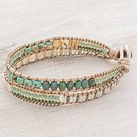 Glass beaded wristband bracelet, 'Hopeful Path' - Glass Beaded Wrap Bracelet in Green and Beige from Guatemala