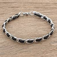 Leather and stainless steel bracelet, 'Midnight Power' - Reclaimed Black Leather Stainless Steel Wristband Bracelet