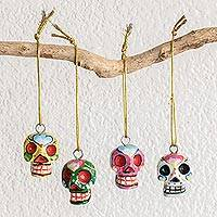 Wood ornaments, 'Traditional Skulls' (set of 4) - Wood Floral Skull Ornaments from Guatemala (Set of 4)