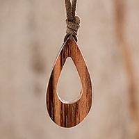 Wood pendant necklace, 'Natural Silhouette' - Drop-Shaped Adjustable Wood Pendant Necklace from Guatemala