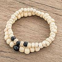 Jade and wood beaded stretch bracelets, 'Black Light' (pair) - Black Jade and Pinewood Beaded Stretch Bracelets (Pair)