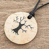 Coconut shell and lava stone pendant necklace, 'Bare Tree' - Coconut Shell and Lava Stone Tree Pendant Necklace