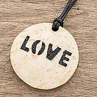 Coconut shell and lava stone pendant necklace, 'Have Love' - Love-Themed Coconut Shell and Lava Stone Pendant Necklace