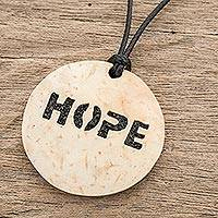 Coconut shell and lava stone pendant necklace, 'Have Hope' - Hope-Themed Coconut Shell and Lava Stone Pendant Necklace