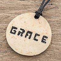 Coconut shell and lava stone pendant necklace, 'Have Grace' - Grace-Themed Coconut Shell and Lava Stone Pendant Necklace