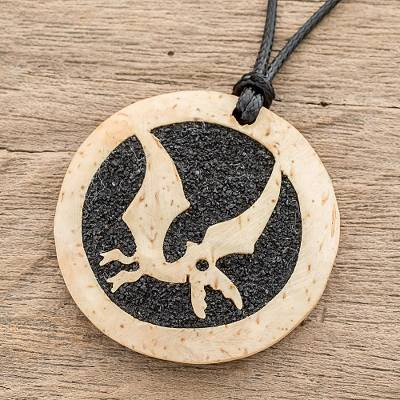 Coconut shell and lava stone pendant necklace, Microraptor