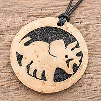 Coconut shell and lava stone pendant necklace, 'Triceratops' - Coconut Shell and Lava Stone Triceratops Pendant Necklace