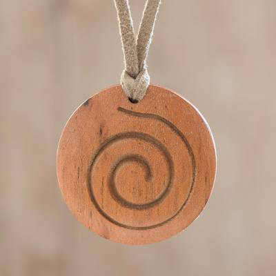 Wood pendant necklace, 'Conch Circle' - Spiral Motif Circular Wood Pendant Necklace from Guatemala