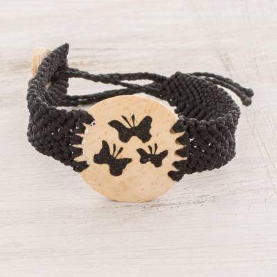 Coconut shell pendant bracelet, 'Three Butterflies' - Butterfly Motif Coconut Shell and Lava Stone Bracelet