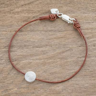 Fine silver pendant bracelet, 'Magic Planet in Brown' - Fine Silver Pendant Bracelet with Brown Leather Cord