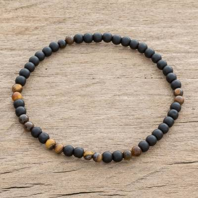 Men's onyx and tiger's eye beaded stretch bracelet, 'Impassioned' - Men's Onyx and Tiger's Eye Beaded Stretch Bracelet
