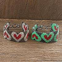 Beaded wristband friendship bracelets, 'Hearts and More Hearts' (pair) - Adjustable Beaded Heart Motif Friendship Bracelets (Pair)