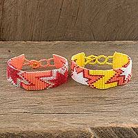 Beaded wristband friendship bracelets, 'Twin Stars in Peach' (pair) - Star Motif Wristband Friendship Bracelets in Peach (Pair)