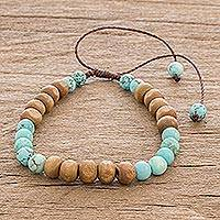 Beaded bracelet, 'Land and Sea' - Unisex Wood and Recon Turquoise Bracelet