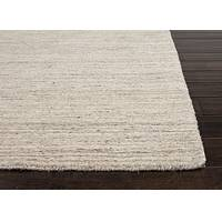 Hand loomed taupe/ivory solid wool area rug, 'Vanilla Ivory' - Solid Handloomed Wool Ivory/Taupe Area Rug