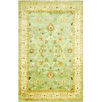 Classic oriental blue/ivory wool area rug, 'Margaret' - Classic Oriental Blue/Ivory Wool Area Rug