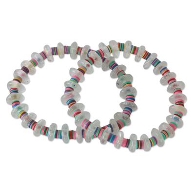 Beaded stretch bracelets, 'Odo Akoma' (pair) - Contemporary West African Eco-friendly Womens Bracelets