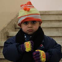 Hats and gloves for 4 Syrian children