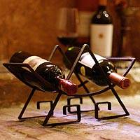 Steel wine bottle holder, 'Inca Glyph' - Steel wine bottle holder