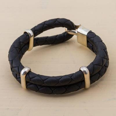 Men's leather bracelet, 'Night's Paths' - Artisan Crafted Leather and Sterling Silver Braided Bracelet