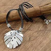 Sterling silver and leather pendant necklace, 'Tropical Leaf' - Sterling silver and leather pendant necklace