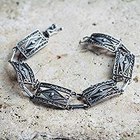 Silver filigree link bracelet,