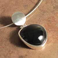 Onyx pendant necklace, 'Allegiance' - Fair Trade Modern Sterling Silver and Onyx Pendant Necklace