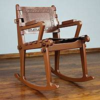 Mohena wood and leather rocking chair,