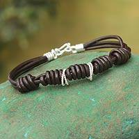 Sterling silver and leather cord bracelet, 'Love Knots' - Leather Cord Bracelet