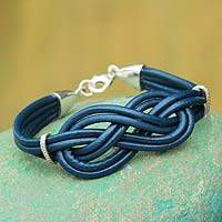 Sterling silver and leather wristband bracelet, 'Blue Love Knot' - Handcrafted Leather Braided Silver Knot Artisan Bracelet