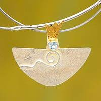 Gold accent aquamarine pendant necklace,