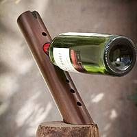 Mohena wood wine bottle holder, 'Andean Melody' - Handcrafted Mohena Wood Wine Bottle Holder