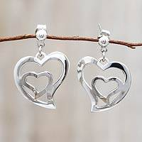 Sterling silver dangle earrings, 'Your Heart in Mine' - Handmade Silver Heart Earrings