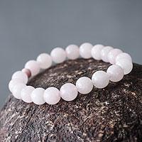 Rose quartz and ceramic stretch bracelet, 'Pink Whisper' - Handmade Pink Rose Quartz Stretch Bracelet from Peru