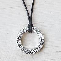 Sterling silver and leather pendant necklace, 'Continuity' - Textured Sterling Silver Circle Pendant on Leather Necklace