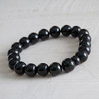 Agate stretch bracelet, 'Galactic Night' - Handmade Black Agate Beaded Stretch Bracelet from Peru