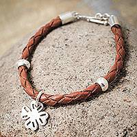 Leather braided bracelet, 'Four Leaf Clover' - Brown Braided Leather Bracelet and Silver Lucky Clover Charm