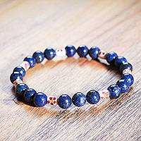 Lapis lazuli and ceramic beaded stretch bracelet, 'Floral Universe' - Hand Crafted Lapis Lazuli and Ceramic Beaded Bracelet