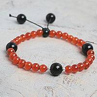 Carnelian and agate stretch bracelet, 'Radiant Dawn' - Beaded Andean Carnelian Stretch Bracelet with Black Agate