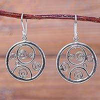 Sterling silver dangle earrings, 'Magical Circles' - Artisan Crafted Circle Theme Sterling Silver Earrings