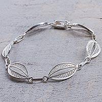Sterling silver filigree link bracelet, 'Sparkling Crescents' - 925 Sterling Silver Filigree Oval Link Bracelet from Peru