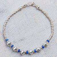 Lapis lazuli beaded bracelet, 'Shining Love' - Sterling Silver and Lapis Lazuli Beaded Bracelet from Peru
