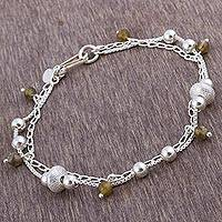 Labradorite charm bracelet, 'Lima Intrigue' - Sterling Silver and Labradorite Charm Bracelet from Peru
