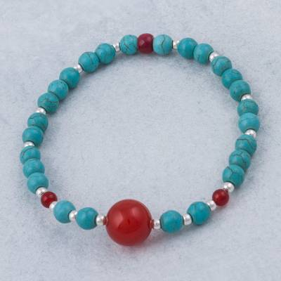Carnelian beaded stretch bracelet, 'Sunset Blue' - Carnelian and Reconsituted Turquoise Bracelet from Peru