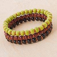 Ceramic beaded stretch bracelets, 'Autumn Spirit' (set of 3) - Three Ceramic Bracelets in Chartreuse Russet and Black