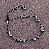 Silver accent hematite station bracelet, 'Heart Encounter' - Andean Hematite Heart Bracelet with Sterling Silver Accents