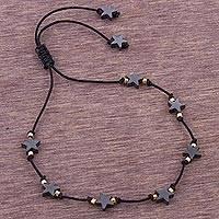 Gold accent hematite station bracelet, 'Star Encounter' - Handcrafted Hematite Star Bracelet with 24k Gold Accents